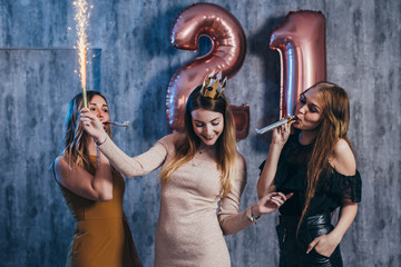 Group of women with fireworks at party having fun.