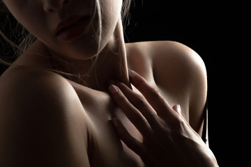 sensual female topless body on black background