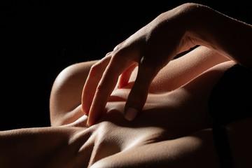 sensual female topless body on black background