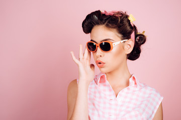 vintage housewife woman make hairstyle. beauty salon and hairdresser. Pin up girl. happy girl in summer glasses. retro woman with fashion makeup. Beauty and fashion. Confident in her style