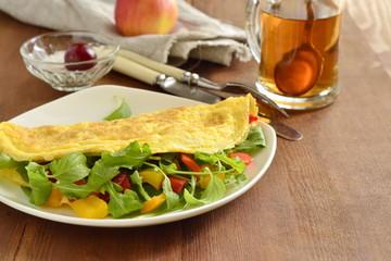 Omelet stuffed from arugula, sweet pepper, copy space