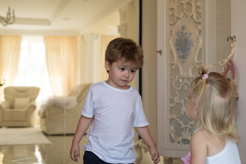 Hair and other stuff. Children development. Small children with stylish hairstyles. Small boy and girl with blond hair. Brother and sister play together. Childhood games. Your hairstyle, our care