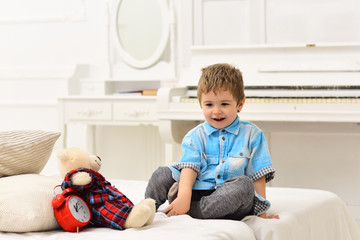 Little boy playing with bear. happy family and childrens day. happy childhood. Care and development. little boy play at home. child play toys. Amazing day. Family weekend. Family traditions