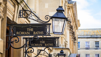 View of Roman Baths Sign in Bath England