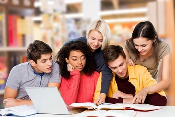 Young students studying on background