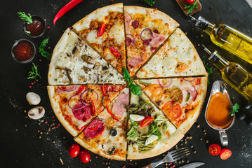 Different pieces of pizza put in one big pizza on black