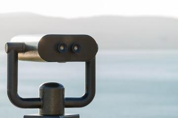 Binoculars on a viewing platform close-up