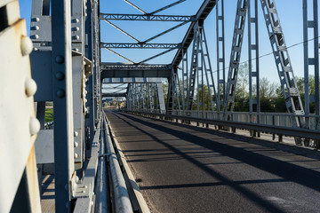Steel bridge over the river on a sunny day