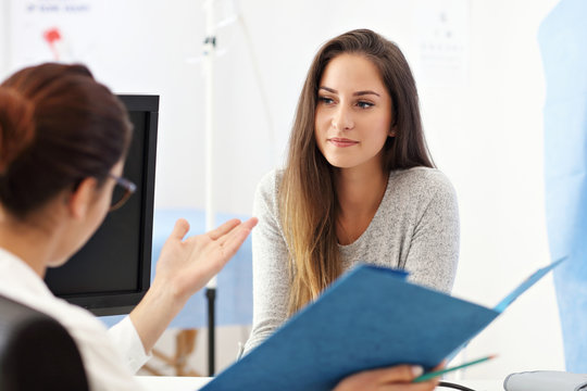 Adult woman having a visit at female doctor's office