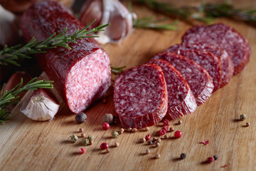 Smoked salami on a old wooden table.
