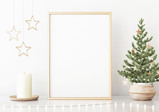 Vertical poster mock up with golden frame, decorated christmas tree, garland lights and holiday decoration on white wall background. 3D rendering.