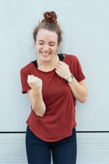 excited young woman punching the air