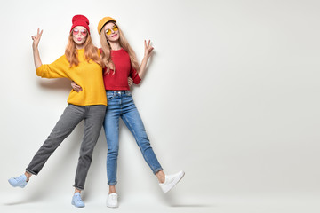 Two Girls Fooling Around. Fashion Autumn Outfit