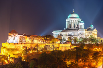 Basilica of the Blessed Virgin Mary in city Estergom - the first capital of Hungary, Europe. Amazing night view of illuminated old Architecture. Famous travel destination.