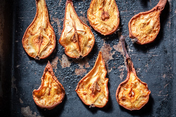 Healthy sun dried pears on old baking tray