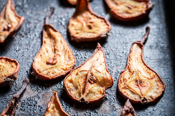 Tasty sun dried pears on old baking tray