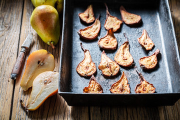 Homemade sun dried pears on old baking tray