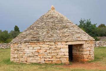 A modern day reconstruction of a kazun near Vodnjan in Istria, Croatia - a traditional dry wall shelter constucted for farmers and shepherds