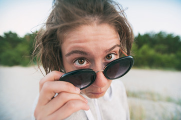 Closeup portrait of funny pretty nerdy girl with sunglasses