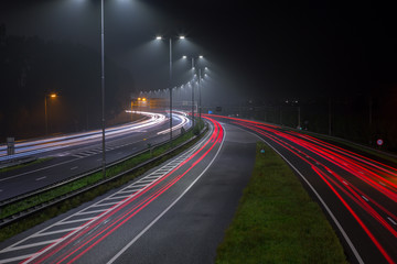 Red tail lights on the A2 highway at night out of Amsterdam in the Netherlands.