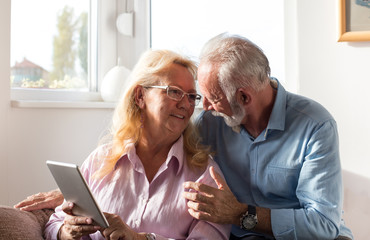 Elderly couple with tablet