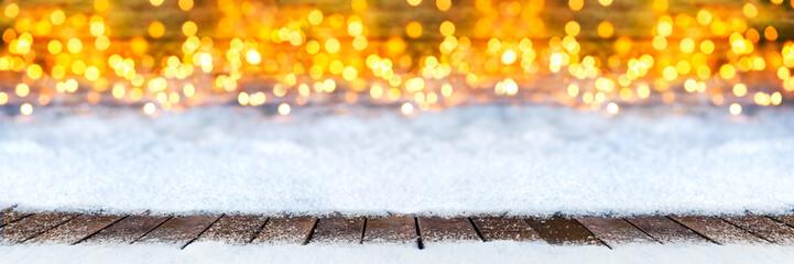 christmas xmas snow bokeh background with many lights and empty ice blue snow copy space / weihnachten hintergrund warm golden lichter bokeh schnee hintergrund vorlage textfreiraum
