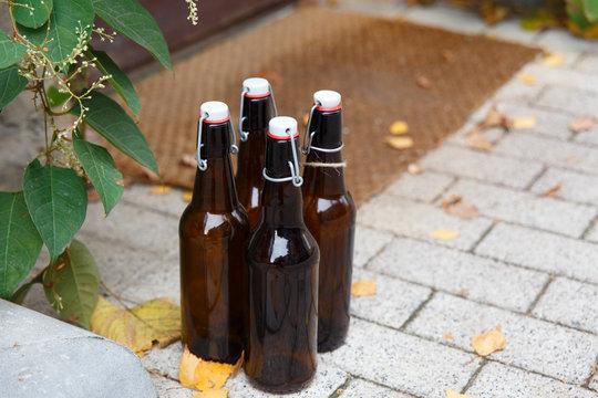 Four empty beer bottles