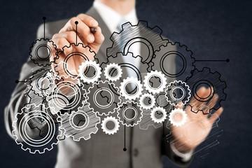 Businessman and analytics symbols on grey background