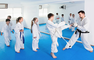 Positive children practicing karate moves