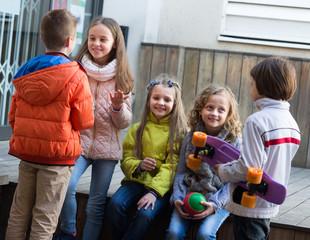 Junior kids chatting outdoor .