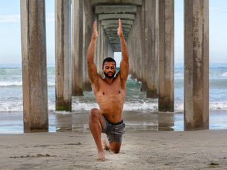 Male Yoga Instructor in Low Lunge Pose with Arms Overhead