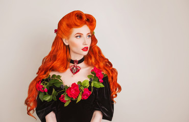 Gothic girl with red hair and red lips with stylish hairstyle in studio. Beauty redhead model with hairstyle on gray background. Renaissance perfect queen. Gothic vampire with long red hair