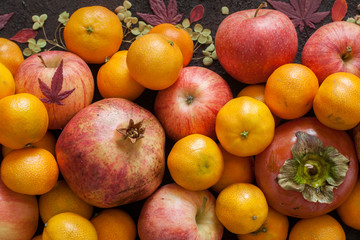 Italian autumn harvest: garnet, mandarins, persimmons, apples.