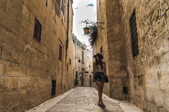 Woman on the ancient streets of Mdina, Malta