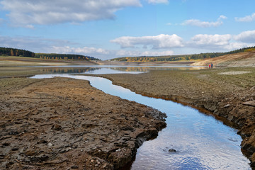 View to the dam wall of a dam with low water level, the dryness is clearly visible, consequence of the hot summer 2018 - Location: Germany, Saxony