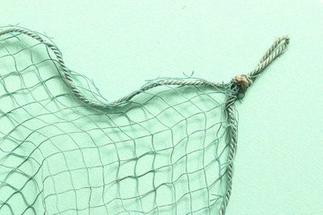 Fishing net with space for your text. Background for a fishery theme.
