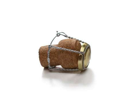Brown champagne cork and muselet, isolated on white background