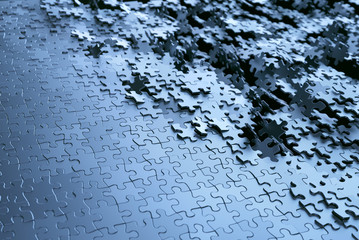 Jigsaw puzzle background. Image of puzzle pieces in chrome gray metal.