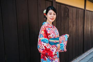 raveler with kimono standing in city in Japan