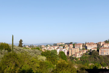 Village in the Tuscan countryside as seen from Siena, Italy, located in Tuscany