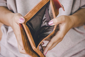 poor woman hand open empty wallet looking for money ,broke ,bankrupt concept