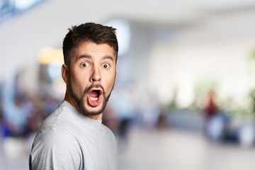 Surprised bearded man looking at camera