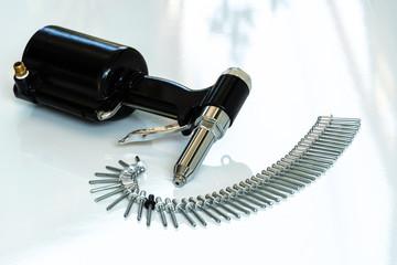Rivet Gun and Rivets , Pneumatic rivet gun and Pop rivets on a white background.