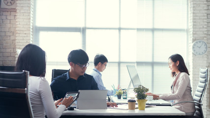 Asian people working in office