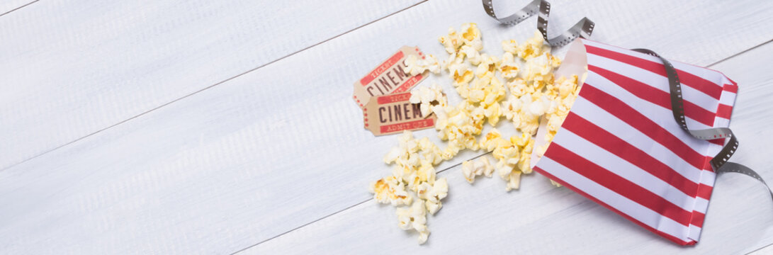two tickets and popcorn for going to the movies