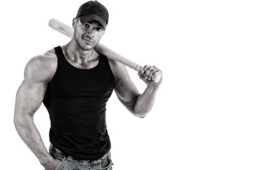 Handsome muscular baseball player posing in front of white background