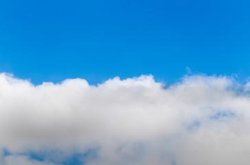 Half blue sky and half sky with cloud