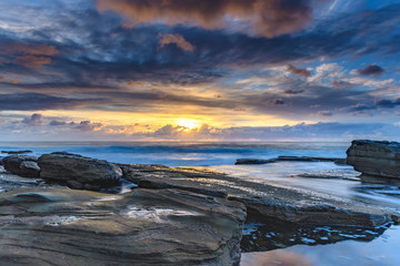 An Atmospheric Coastal Sunrise