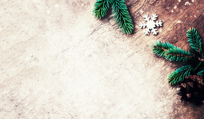 Christmas fir tree with decorations on dark grunge wooden board. Christmas vintage Background, copy space. Flat lay, Top view..