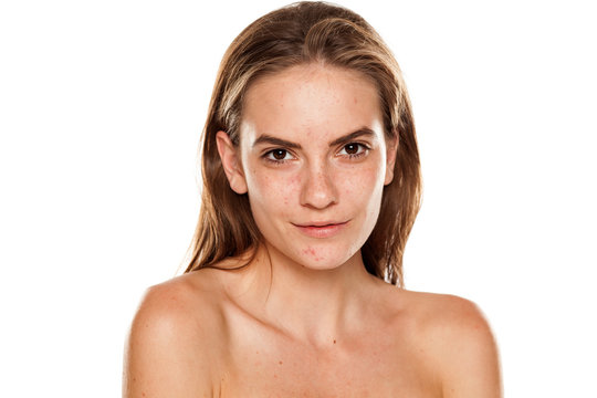 Portrait of young beautiful smiling woman with no makeup on white backgeound